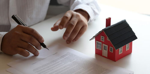 Customer signing contract about home loan agreement for new house